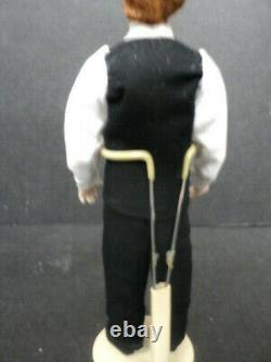 DOLLHOUSE PORCELAIN DOLL- MAN IN BLACK VEST With RED HAIR